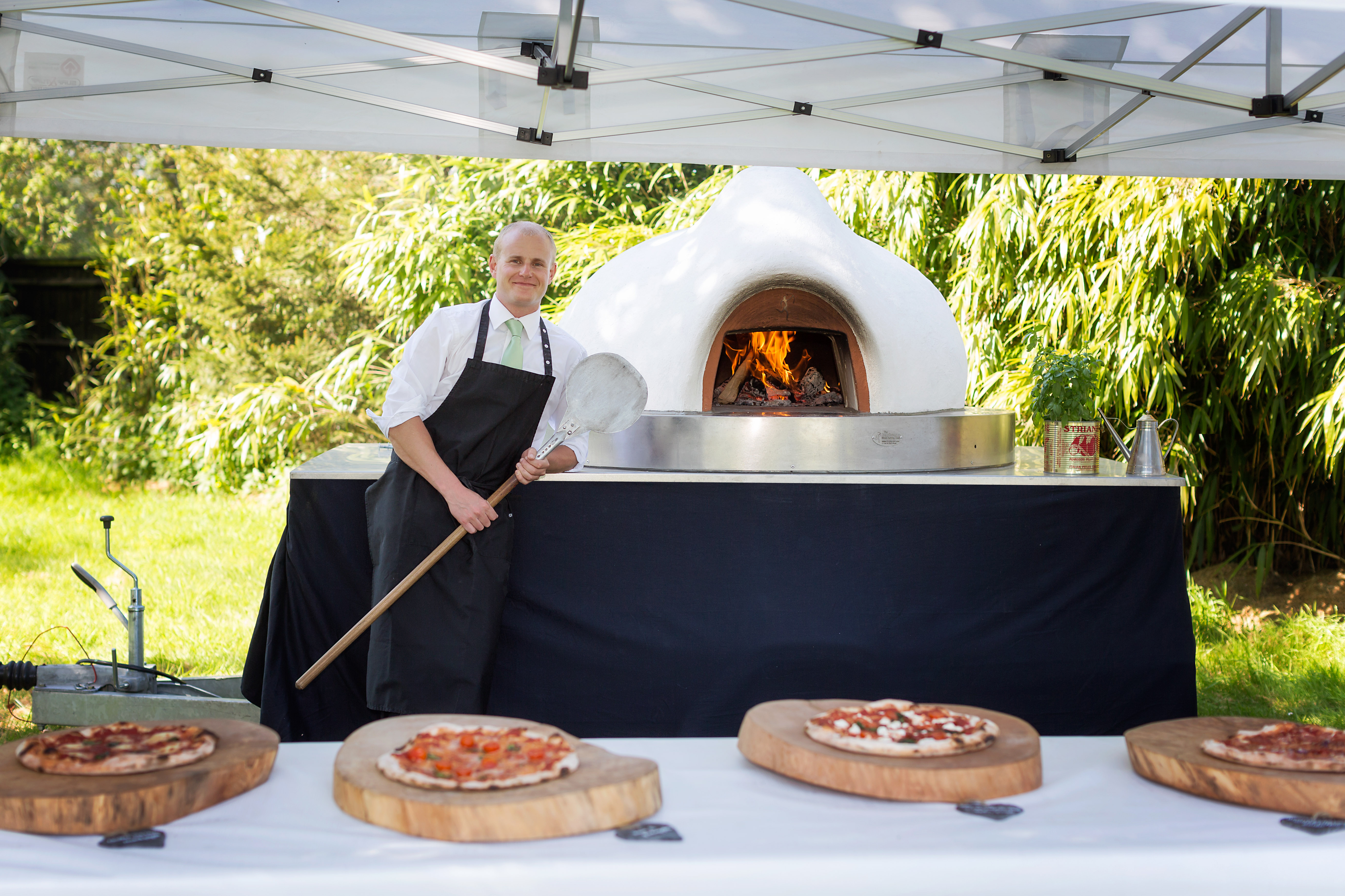 Nick from Pizza monkey and his pizza stove