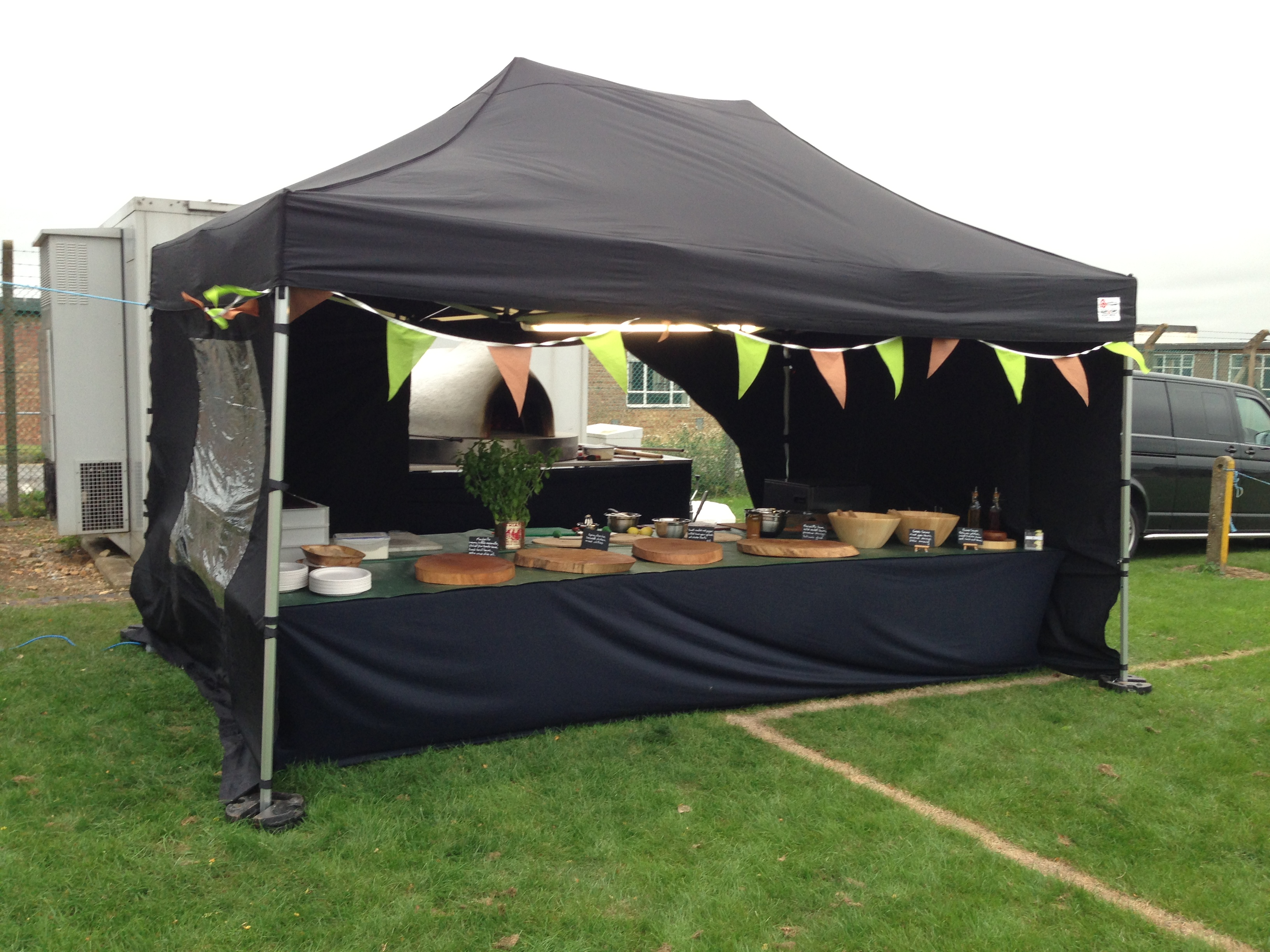 Pizza Monkey catering tent with wood fire oven